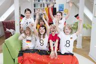 Group of kids watching soccer world championship, cheering - NEKF00012
