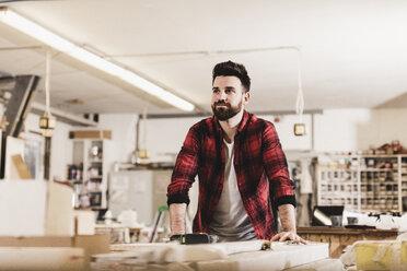 Portrait of confident man in workshop - UUF12717