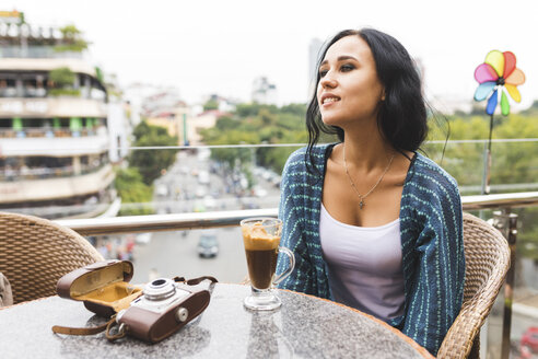 Vietnam, Hanoi, young woman drinking typical egg coffee - WPEF00056