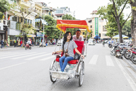 Vietnam, Hanoi, young woman on a riksha exploring the city - WPEF00059