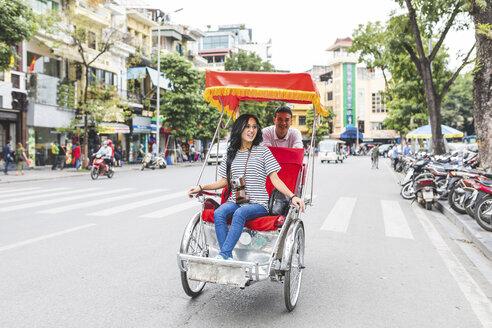 Vietnam, Hanoi, young woman on a riksha exploring the city - WPEF00059