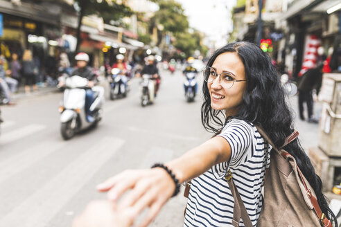 Vietnam, Hanoi, portrait of smiling young woman on the street in the city - WPEF00062