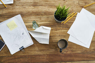 Papers on wooden table in office - FMKF04854
