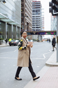 UK, London, fashionable  businesswoman crossing the street - MAUF01316
