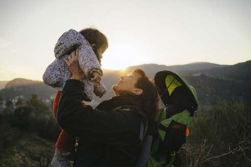 Spain, Barcelona, grandmother with granddaughter during a hike at sunset - GEMF01878