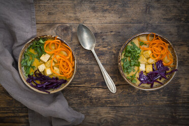Turmeric curry dish with carrot, tofu, red cabbage and parsley in bowl - LVF06674