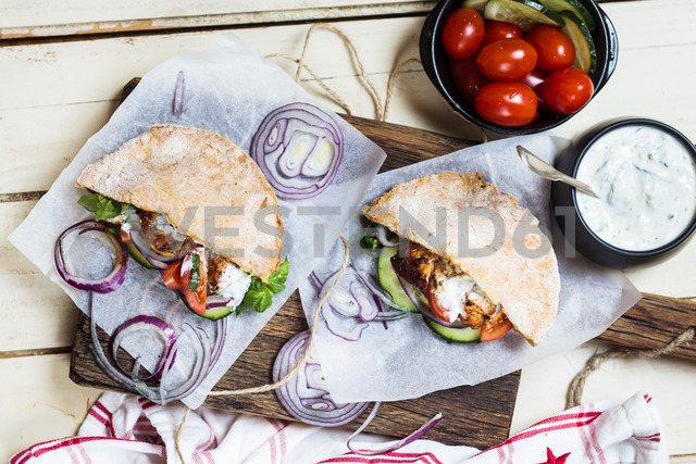 Chicken gyros, chicken, salad, tomato, cucumber, onion, tzatziki, homemade glutenfree pita bread - SBDF03453