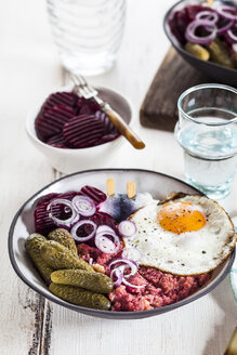 Labskaus, rollmops, pickled gherkin, beetroot salad, onion and fried egg - SBDF03459