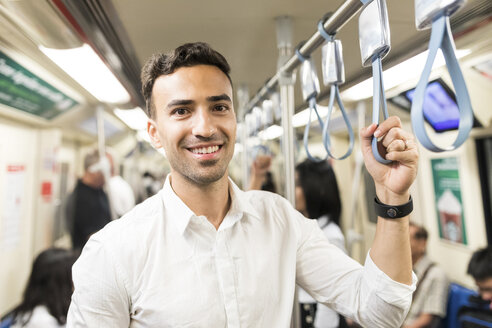 Portrait of smiling businessman in the subway - WPEF00088