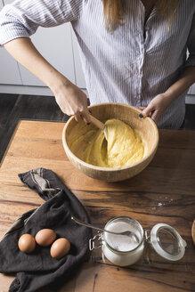 Woman stirring dough - MAUF01335
