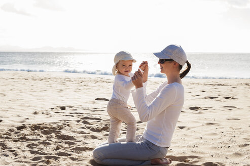 Happy mother with little daughter on the beach - DIGF03271