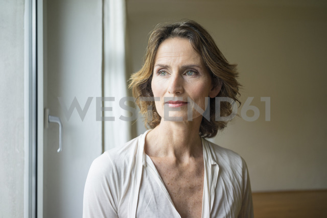 Portrait of pensive mature woman at the window - MOEF00744