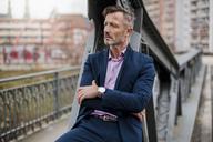 Portrait of stylish mature businessman wearing blue suit - DIGF03276