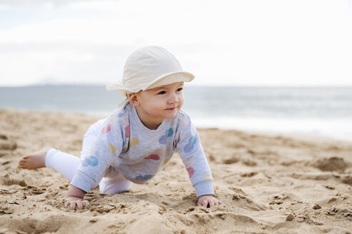 Spain, Lanzarote, baby girl crawling on the beach - DIGF03287