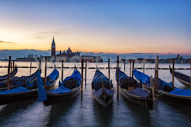 Italy, Veneto, Venice, Gondolas in front of San Giorgio Maggiore, early morning - YRF00202