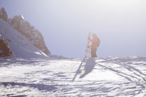 Austria, Tyrol, Mutters, freeride skier ascending mountain - CVF00140