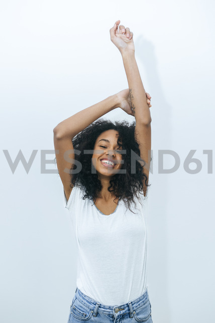 Portrait of young woman laughing and dancing - KIJF01900