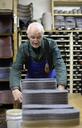 Senior shoemaker working on slipper templates in workshop - BFRF01814