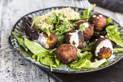 Plate of Falafel, salad, yogurt sauce with mint and Tabbouleh - SARF03546