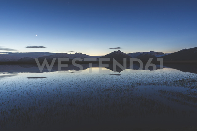 Iceland, Hofn, View of lake and mountains after sunset - WPEF00100