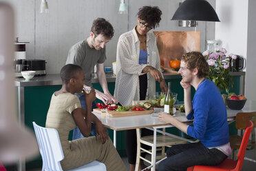 Friends preparing food in kitchen - FSIF00218