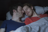 Relaxed young gay couple sleeping in bed - FSIF00224