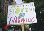 Close-up of global warming sign in city - FSIF00299