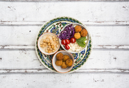 Sweet potato balls, Couscous, Hummus and vegetables in bowls - LVF06687