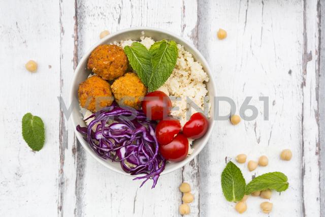 Buddha bowl of sweet potato balls, Couscous, Hummus and vegetables - LVF06690