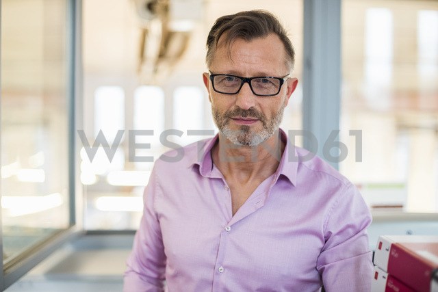 Portrait of confident mature businessman in office - DIGF03321