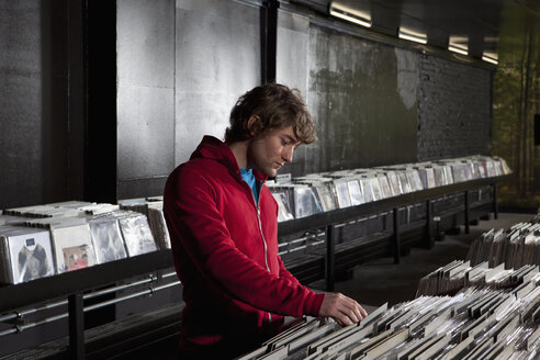 A young man looking through records at a record store - FSIF00368