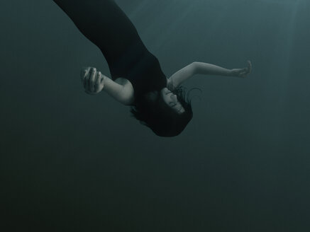 A woman with closed eyes and blank expression, sinking underwater - FSIF00443