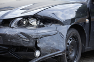 Damaged car with distorted reflection of town - FSIF00446