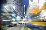 Buses moving through a city at night, blurred motion - FSIF00461
