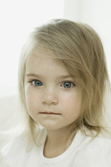 A young girl with a tear falling down her cheek - FSIF00473