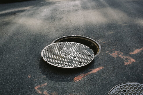 A manhole cover partially removed, close-up - FSIF00575