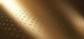 Multiple rows of random letters on a curving gold surface - FSIF00587