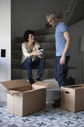 A mixed age couple packing moving boxes - FSIF00623