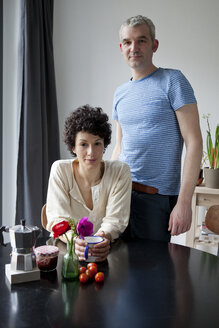 A serious hip mixed age couple at the breakfast table - FSIF00629