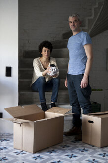 A mixed age couple packing moving boxes - FSIF00638