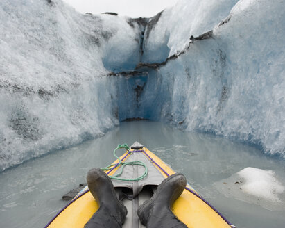 Kayaking between canal walls of Valdez Glacier, Alaska, USA - FSIF00686