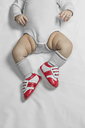 A baby boy wearing baby soccer shoes, waist down - FSIF00692