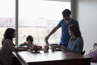 Family having breakfast at dining table - FSIF00794