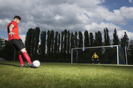Full length of soccer player kicking ball at goal - FSIF00899