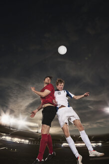 Male soccer players heading ball during match - FSIF00914