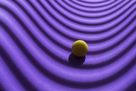 Yellow sphere over a geometric purple background, 3D Rendering - DRBF00044