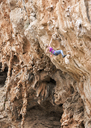 Greece, Kalymnos, woman climbing in rock wall - ALRF00901