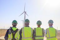 Rear view of four engineers on a wind farm - ZEF14973