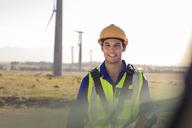 Portrait of smiling technician on a wind farm - ZEF14976