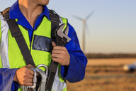 Close-up of technician with equipment on a wind farm - ZEF14988
